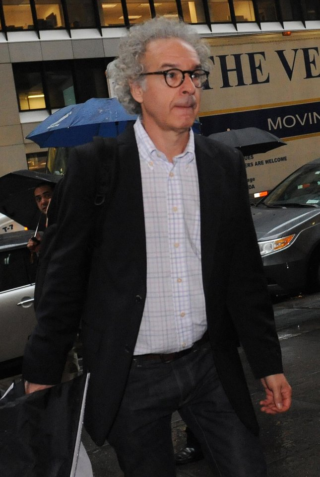 Photo -   NHL players association general counsel Don Zavelo arrives at NHL headquarters in New York, Friday, Sept. 28, 2012. With the clock ticking down to the start of the season, the NHL and its locked-out players are talking again. (AP Photo/ Louis Lanzano)