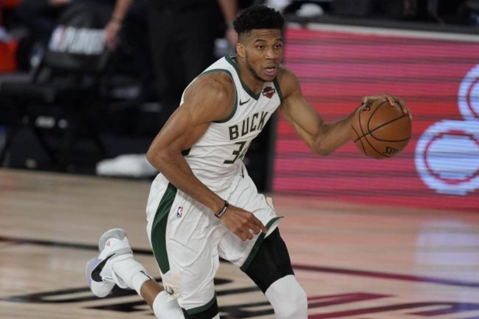 Photo -  Milwaukee Bucks' Giannis Antetokounmpo was named the MVP of the NBA on Friday for the second straight year. [AP Photo/Mark J. Terrill]