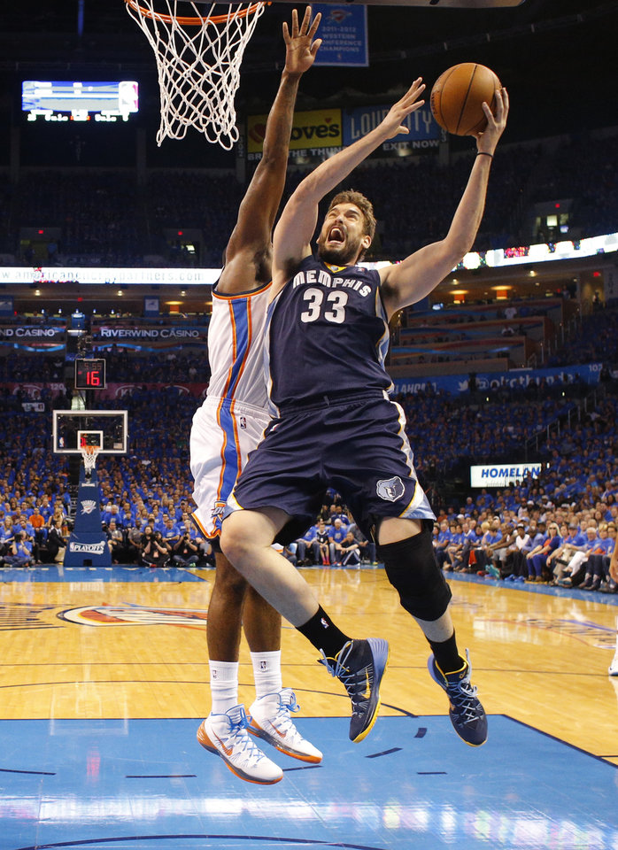 Photo - Memphis' Marc Gasol (33) goes to the basket during Game 1 in the first round of the NBA playoffs between the Oklahoma City Thunder and the Memphis Grizzlies at Chesapeake Energy Arena in Oklahoma City, Saturday, April 19, 2014. Photo by Nate Billings, The Oklahoman