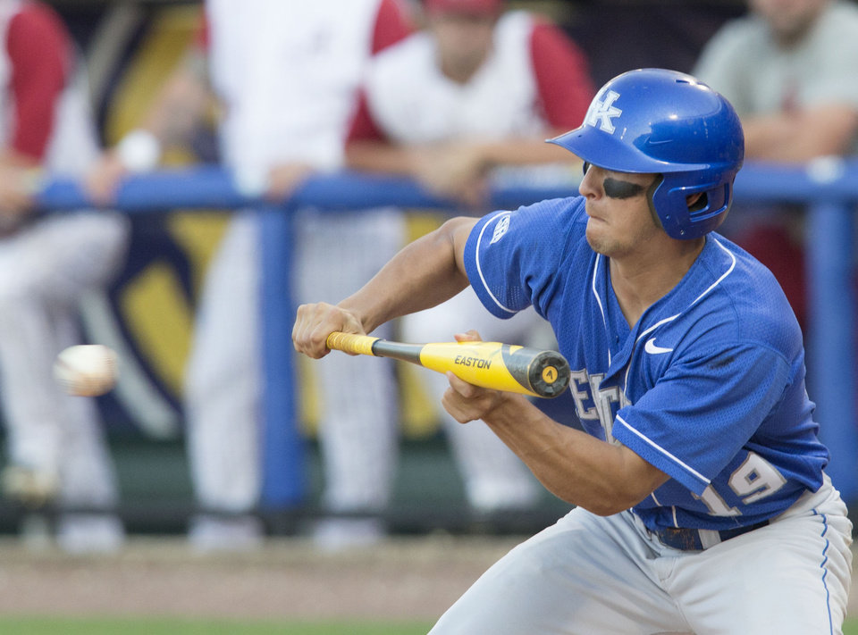 Photo - Kentucky's Austin Cousino bunts against Alabama during the Southeastern Conference NCAA college baseball tournament Tuesday, May 20, 2014, in Hoover, Ala. (AP Photo/Hal Yeager)