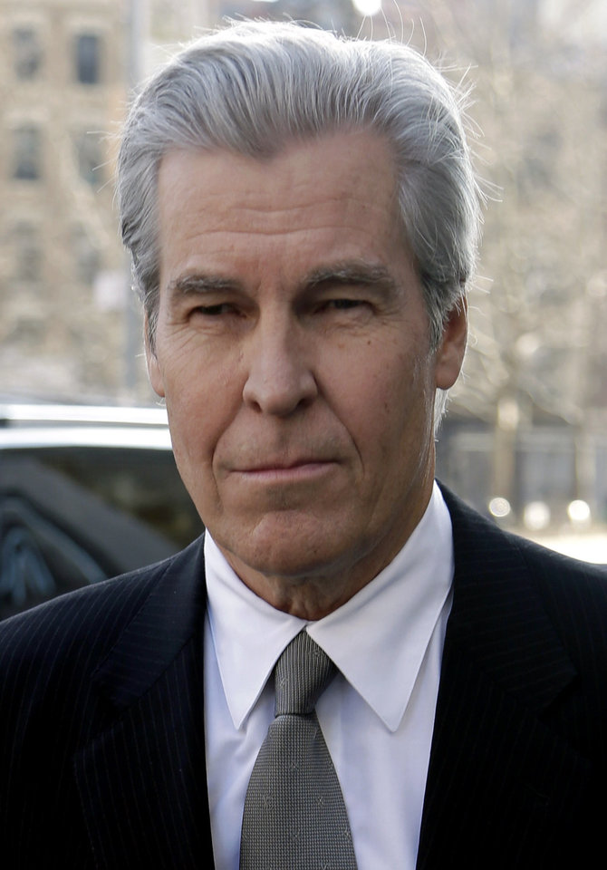 Photo - Macy's Chairman, President and CEO Terry Lundgren arrives to court in New York, Monday, Feb. 25, 2013. Lundgren is scheduled to testify in New York State Supreme Court on Monday in a trial that pits the department store chain against rival J.C. Penney Co. over a partnership with home diva Martha Stewart. (AP Photo/Seth Wenig)