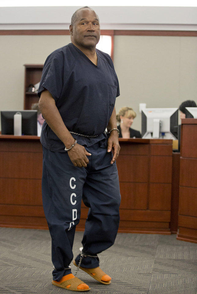 Photo - O.J. Simpson returns to the witness stand to testify after a break during an evidentiary hearing in Clark County District Court, Wednesday, May 15, 2013 in Las Vegas. Simpson, who is currently serving a nine to 33-year sentence in state prison as a result of his October 2008 conviction for armed robbery and kidnapping charges, is using a writ of habeas corpus, to seek a new trial, claiming he had such bad representation that his conviction should be reversed. (AP Photo/Julie Jacobson, Pool)