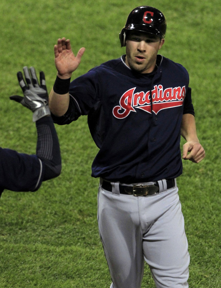 Photo -   Cleveland Indians' Jason Kipris gets high-fives after scoring against the Chicago White Sox on a double by Asdrubal Cabrera in the third inning during a baseball game, Monday, Sept. 24, 2012, in Chicago. (AP Photo/John Smierciak)