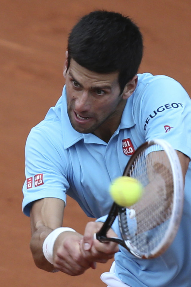 Photo - Serbia's Novak Djokovic returns the ball during the second round match of the French Open tennis tournament against France's Jeremy Chardy at the Roland Garros stadium, in Paris, France, Wednesday, May 28, 2014. (AP Photo/David Vincent)