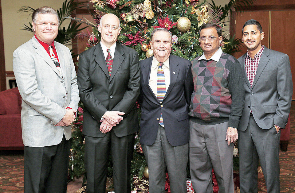 Above: Bob Lewter, Mike Farney, Larry McAtee, Champ Patel, Harshil Patel.