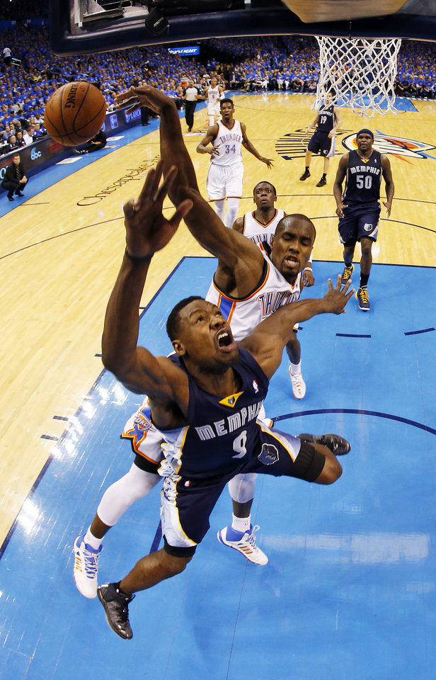 Photo - Oklahoma City's Serge Ibaka (9) blocks the shot of Memphis' Tony Allen (9) during Game 1 in the first round of the NBA playoffs between the Oklahoma City Thunder and the Memphis Grizzlies at Chesapeake Energy Arena in Oklahoma City, Saturday, April 19, 2014. Photo by Nate Billings, The Oklahoman