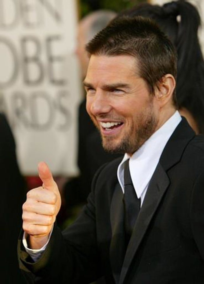 "Tom Criuse, nominated for best actor in a drama for his work on ""The Last Samurai,"" gives the thumbs-up as he arrives for the 61st Annual Golden Globe Awards on Sunday, Jan. 25, 2004, in Beverly Hills, Calif.  (AP Photo/Kevork Djansezian)"
