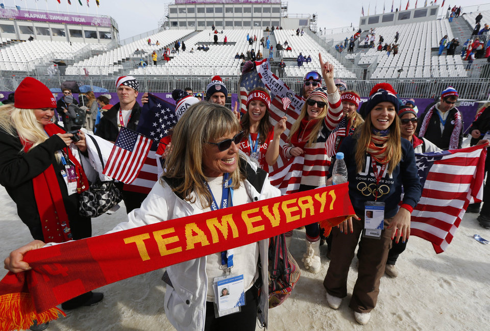 Photo - Lauren Anderson, the mother of  U.S. snowboarder Jamie Anderson celebrates with fans after Jamie Anderson won the women's snowboard slopestyle final at the 2014 Winter Olympics, Sunday, Feb. 9, 2014, in Krasnaya Polyana, Russia. (AP Photo/Sergei Grits)