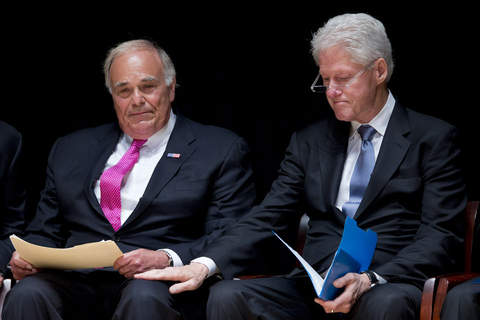 Photo - Former President Bill Clinton places a hand on former Pennsylvania Gov. Ed Rendell after Rendell spoke during a public memorial service for Philadelphia Inquirer co-owner Lewis Katz, Wednesday, June 4, 2014, at Temple University in Philadelphia. Katz and six others died when his private jet crashed during takeoff on Saturday, May 31, 2014, in Massachusetts. He was 72.  (AP Photo/Matt Rourke)