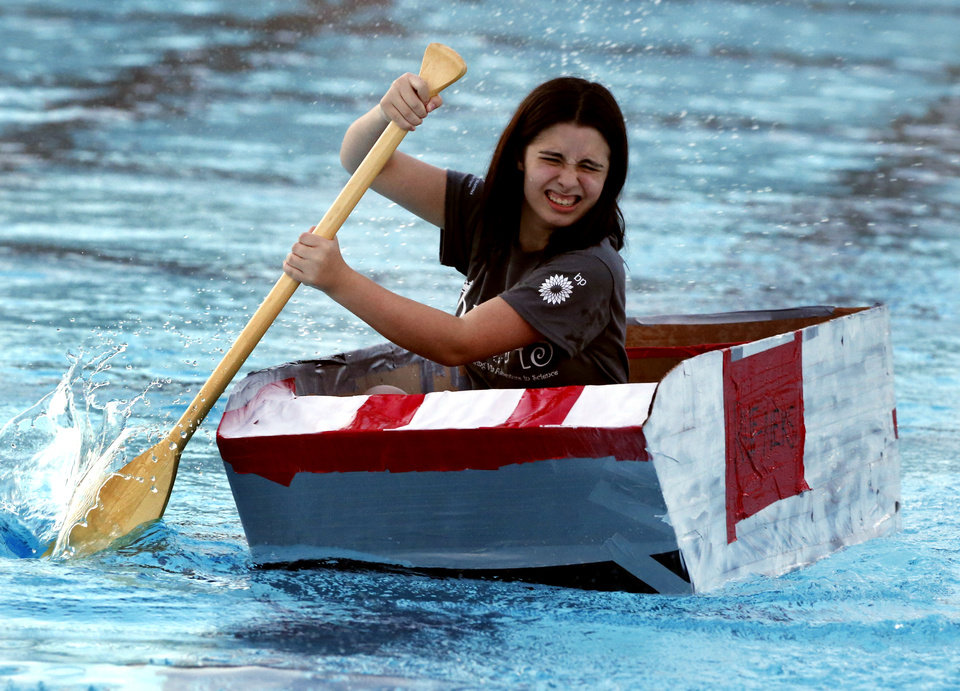 Photo -  Haylie McDowell, Broken Arrow high school junior, paddles toward the finish line in her self-designed boat in a cardboard regatta at OU's summer engineering camp. PHOTO BY STEVE SISNEY, THE OKLAHOMAN   STEVE SISNEY -