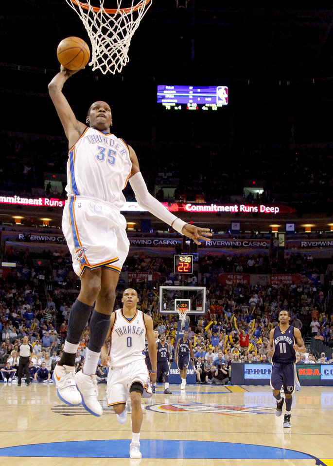 Photo - Oklahoma City' Kevin Durant dunks the ball during the NBA basketball game between the Oklahoma City Thunder and the Memphis Grizzlies at the Ford Center in Oklahoma City on Wednesday, April 14, 2010. 