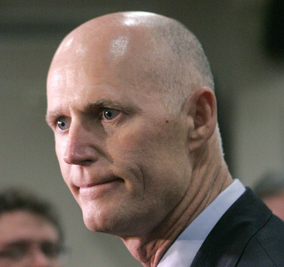 FILE - This June 28, 2012 file photo shows Florida Gov. Rick Scott in Tallahassee, Fla. From the South to the heartland, cracks are appearing in the once-solid wall of Republican resistance to President Barack Obama\'s health care law. One of the most visible opponents of Obama\'s overhaul, Florida Republican Gov. Rick Scott, now says