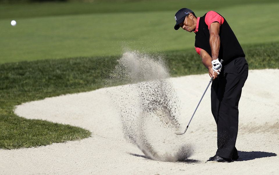 Tiger Woods hits out of a bunker on the 10th hole during the fourth round of the Farmers Insurance Open golf tournament at the Torrey Pines Golf Course, Monday, Jan. 28, 2013, in San Diego. (AP Photo/Gregory Bull)