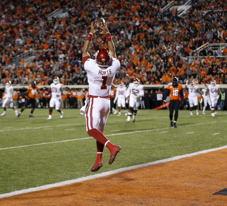 Photo - Oklahoma's Jalen Hurts (1) makes a catch for a touchdown in the second quarter during the Bedlam college football game between the Oklahoma State Cowboys (OSU) and Oklahoma Sooners (OU) at Boone Pickens Stadium in Stillwater, Okla., Saturday, Nov. 30, 2019. [Nate Billings/The Oklahoman]