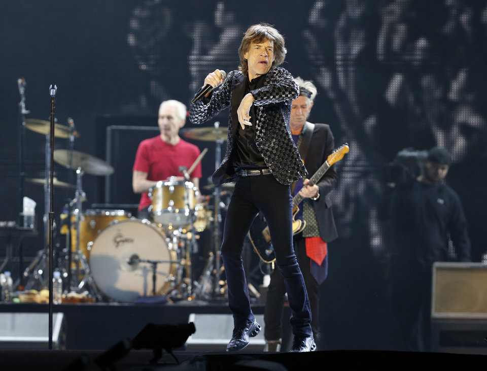 """Photo - FILE - This Feb. 26, 2014 file photo shows Mick Jagger and the Rolling Stones performing during their concert at Tokyo Dome in Tokyo. The Rolling Stones have called off their tour dates in Australia and New Zealand following the death of Mick Jagger's girlfriend and designer L'Wren Scott on Monday, March 17, 2014. The iconic band says in a statement Tuesday they """"are deeply sorry and disappointed to announce the postponement of the rest of their 14 ON FIRE tour."""" (AP Photo/Shizuo Kambayashi, File)"""