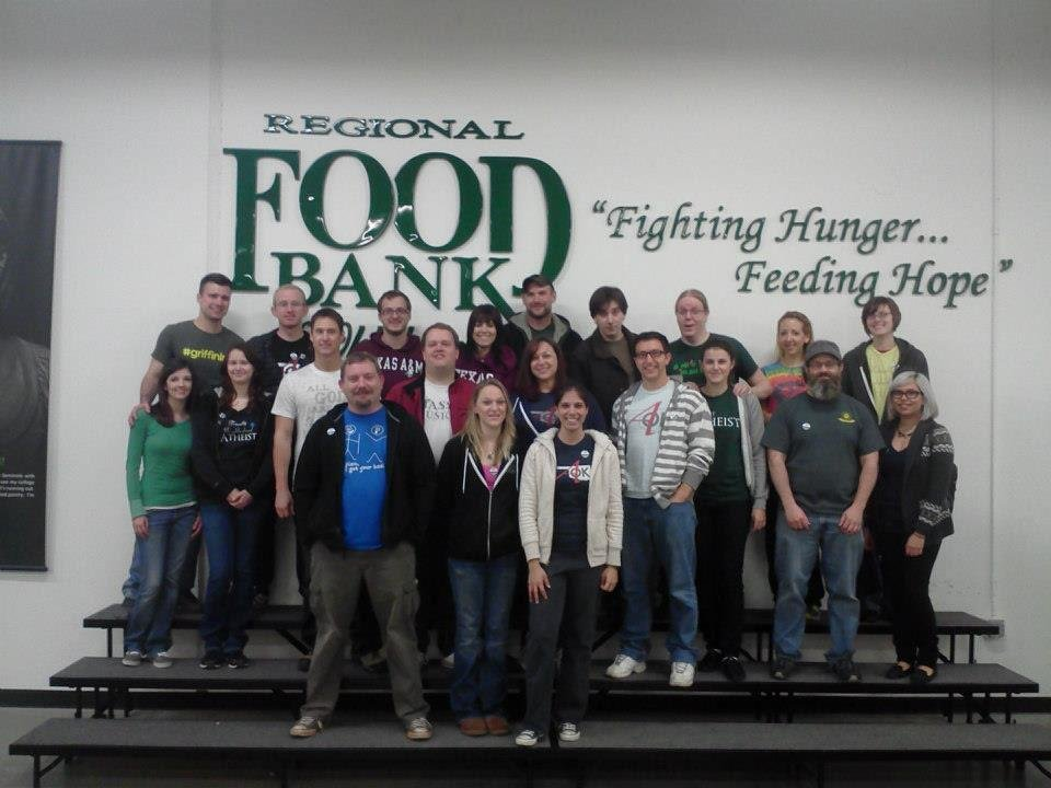 Photo - Several members of Oklahoma Atheists pose for a group photograph after a volunteer project at the Regional Food Bank of Oklahoma. Photo provided
