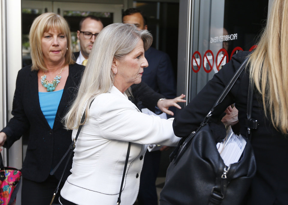 Photo - Maureen McDonnell leaves the federal courthouse in Richmond, Va., on the third day of her and former Governor Bob McDonnell's corruption trial Wednesday, July 30, 2014.  (AP Photo/Richmond Times-Dispatch, Alexa Welch Edlund)