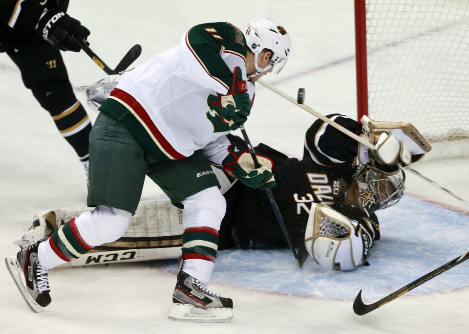 Photo - Minnesota Wild left wing Zach Parise (11) scores against Dallas Stars goalie Kari Lehtonen (32) during the first period of an NHL hockey game March 25, 2013 in Dallas. (AP Photo/ Michael Mulvey)