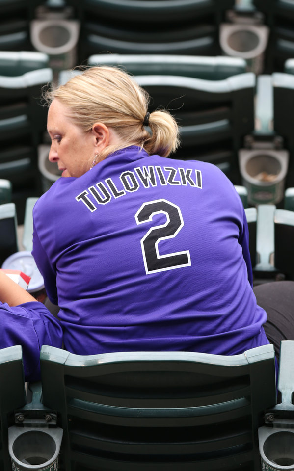 Photo - A fan wears one of the jerseys given to attendees of the Pittsburgh Pirates at Colorado Rockies baseball game in Denver, Saturday, July 26, 2014. The surname of Rockies All-Star shortstop Troy Tulowitzki is misspelled on the shirts. (AP Photo/David Zalubowski)