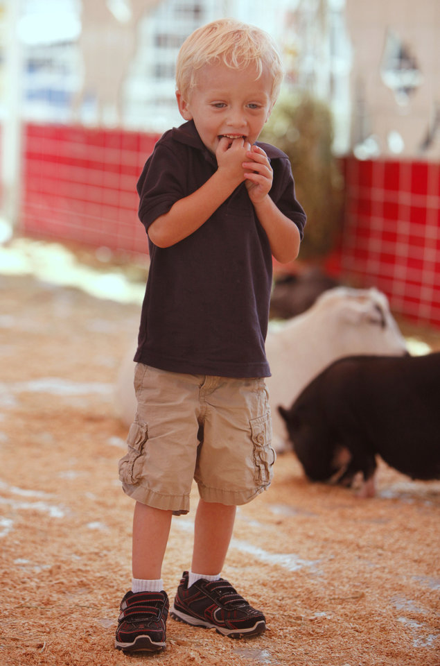 Three year old Holden Howard shows his excitement in the petting zoo at the Oklahoma State Fair at State Fair Park in Oklahoma City, OK, Thursday, September 20, 2012,  By Paul Hellstern, The Oklahoman