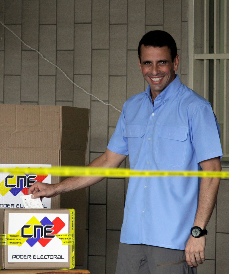 Miranda's  Gov. Henrique Capriles  casts his ballot at a polling station in Caracas, Venezuela, Sunday, Dec. 16, 2012. Venezuelans are choosing governors and state lawmakers in elections that have become a key test of whether President Hugo Chavez's movement can endure if the socialist leader leaves the political stage. (AP Photo/Fernando Llano)