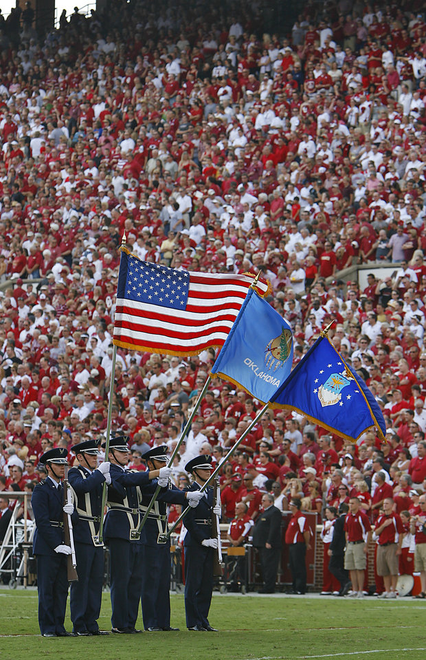 The Air Force Color Guard presents the flags during the National Anthem before the start of the college football game between the University of Oklahoma Sooners (OU) and the Air Force Falcons at the Gaylord Family - Memorial Stadium on Saturday, Sept. 18, 2010, in Norman, Okla.   Photo by Chris Landsberger, The Oklahoman