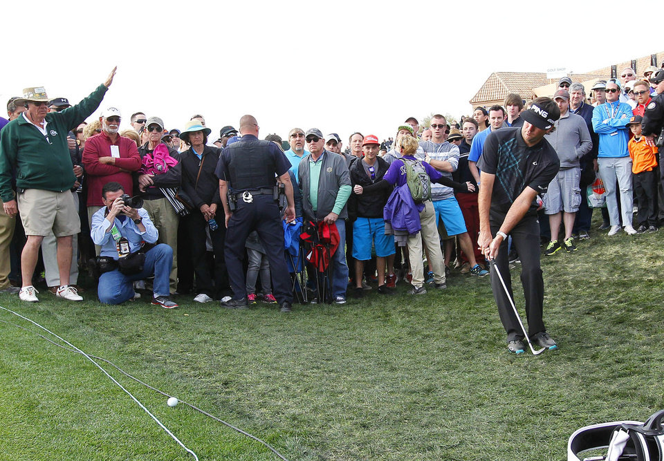 Photo - Bubba Watson hits from the rough behind the green on the 18th hole during the final round of the Phoenix Open golf tournament on Sunday, Feb. 2, 2014, in Scottsdale, Ariz. (AP Photo/Ross D. Franklin)
