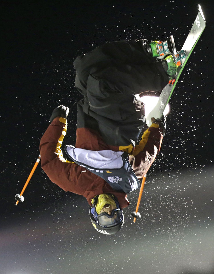 Photo - Lyman Currier, of the United States, competes during the men's U.S. Grand Prix freestyle halfpipe skiing event Saturday, Jan. 18, 2014, in Park City, Utah. Currier came in first place. (AP Photo/Rick Bowmer)