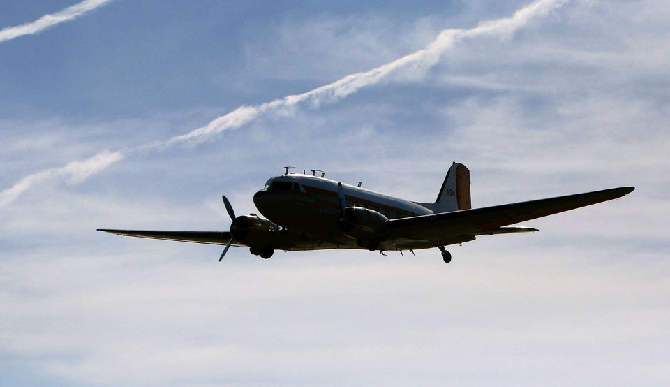 Photo - A DC-3 takes off Thursday from the Mike Monroney Center at Will Rogers World Airport in Oklahoma City for its new home at the Texas Air & Space Museum in Amarillo. Photo by Paul Hellstern, The Oklahoman  Paul Hellstern