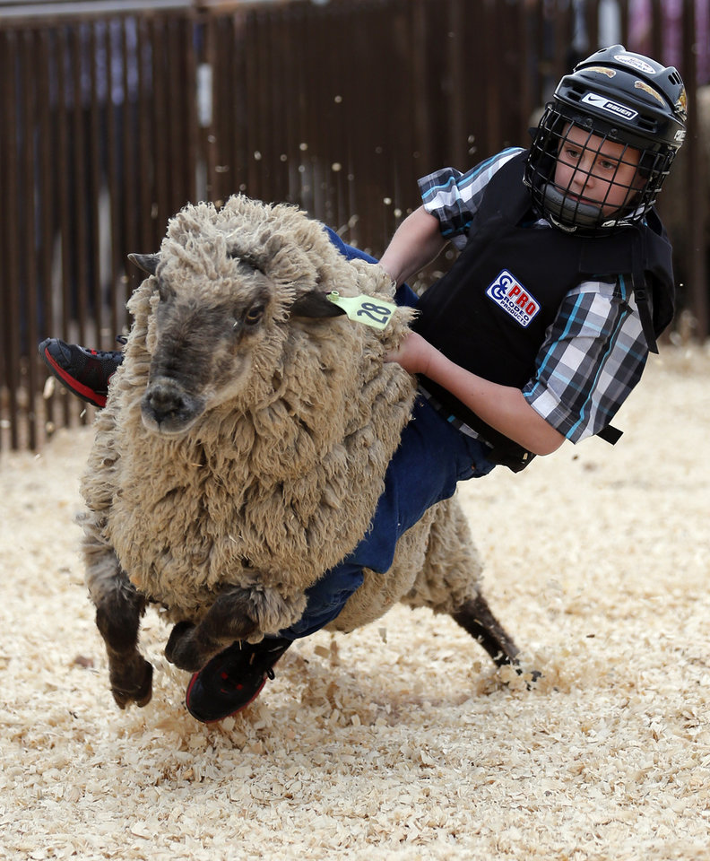 Connor Boyd tries mutton busting for the National Circuit Finals Rodeo at the State Fair Arena in Oklahoma City, Friday, April 5, 2013. Photo by Sarah Phipps, The Oklahoman