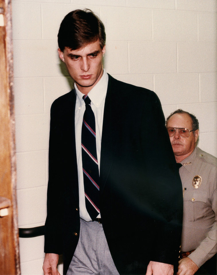 Photo - Murder suspect Michael Hooper is led up a back stairway to make a court appearance in El Reno, Okla.,  Feb. 17, 1994, Photo by Roger Klock, The Oklahoman