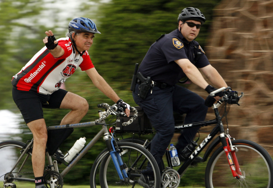 Photo - Tim Harrington and master police officer Tim Smith ride to the Bike to Work event in Norman, Okla. on Friday, May 1, 2009..   Photo by Steve Sisney, The Oklahoman