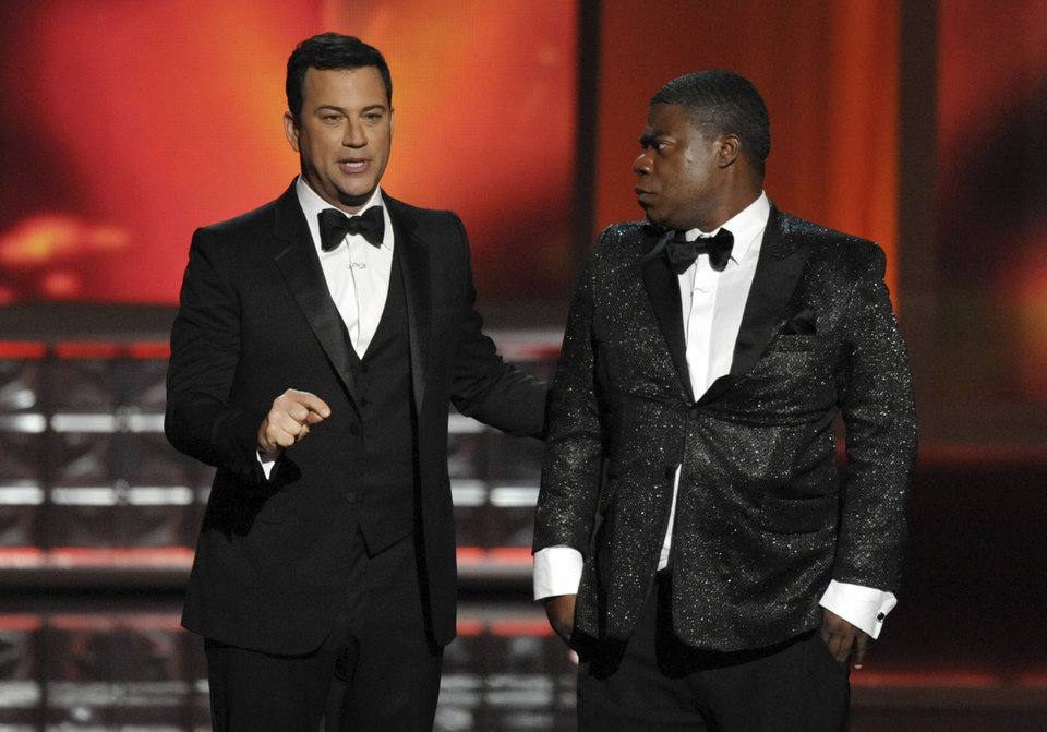 Photo -   Host Jimmy Kimmel, left, and Tracy Morgan perform onstage at the 64th Primetime Emmy Awards at the Nokia Theatre on Sunday, Sept. 23, 2012, in Los Angeles. (Photo by John Shearer/Invision/AP)