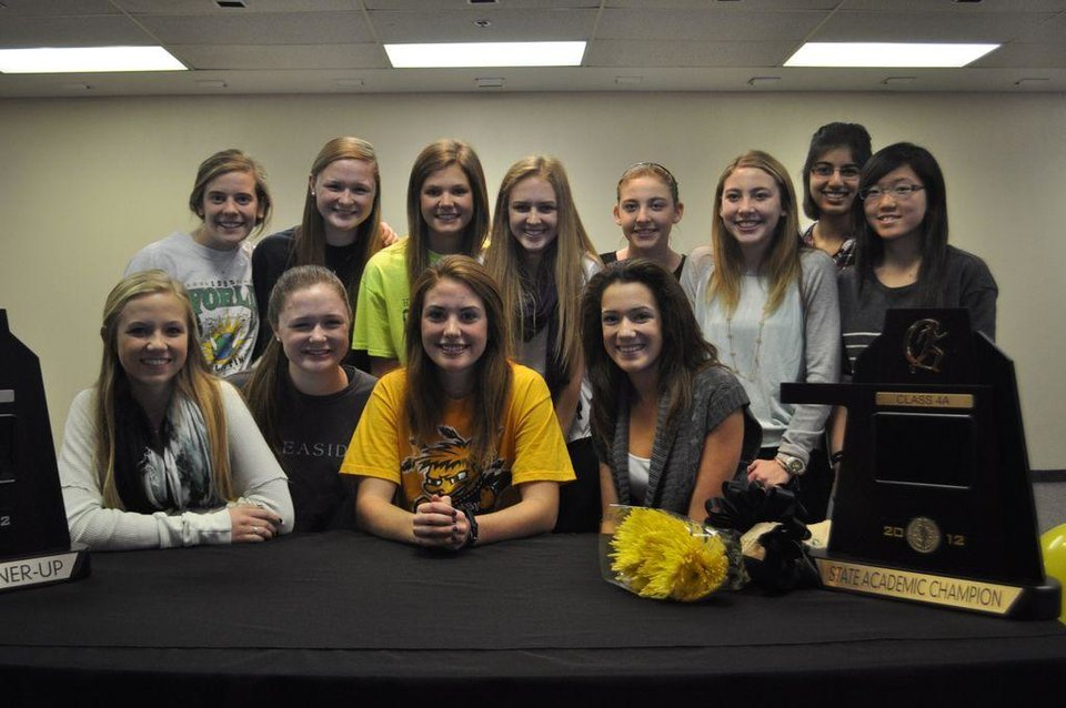 Heritage Hall senior Darby Crynes signs a National Letter of Intent Wednesday to run Cross Country and Track at Wichita State University next year.