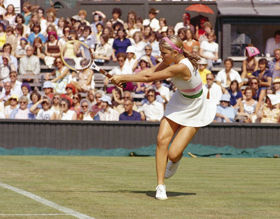 Photo - FILE - This is a 1975 file photo showing Chris Evert playing tennis. Evert won the first of her 18 career Grand Slam titles at the 1974 French Open. When this year's edition of the clay-court Grand Slam tournament begins Sunday May 25, 2014, Evert will be on hand at Roland Garros as a TV analyst for ESPN, watching what's become a changed brand of tennis four decades later. (AP Photo/File)