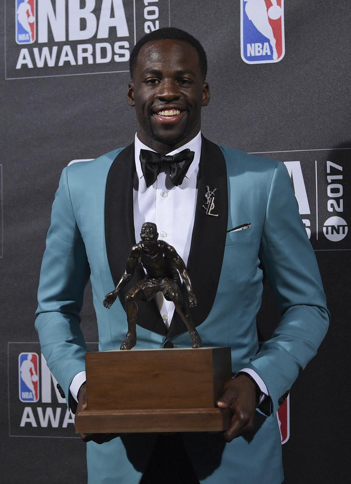 Photo - Kia NBA Defensive Player of the Year & Assist of the Year Award winner, Draymond Green, poses in the press room at the 2017 NBA Awards at Basketball City at Pier 36 on Monday, June 26, 2017, in New York. (Photo by Evan Agostini/Invision/AP)