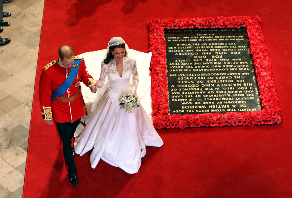 Photo - Prince William and his bride Kate, Duchess of Cambridge, walk past the Tomb of the Unknown Warrior as they leave Westminster Abbey, London, following their marriage, Friday April 29, 2011. (AP Photo/David Jones, Pool)  ORG XMIT: RWAJP123