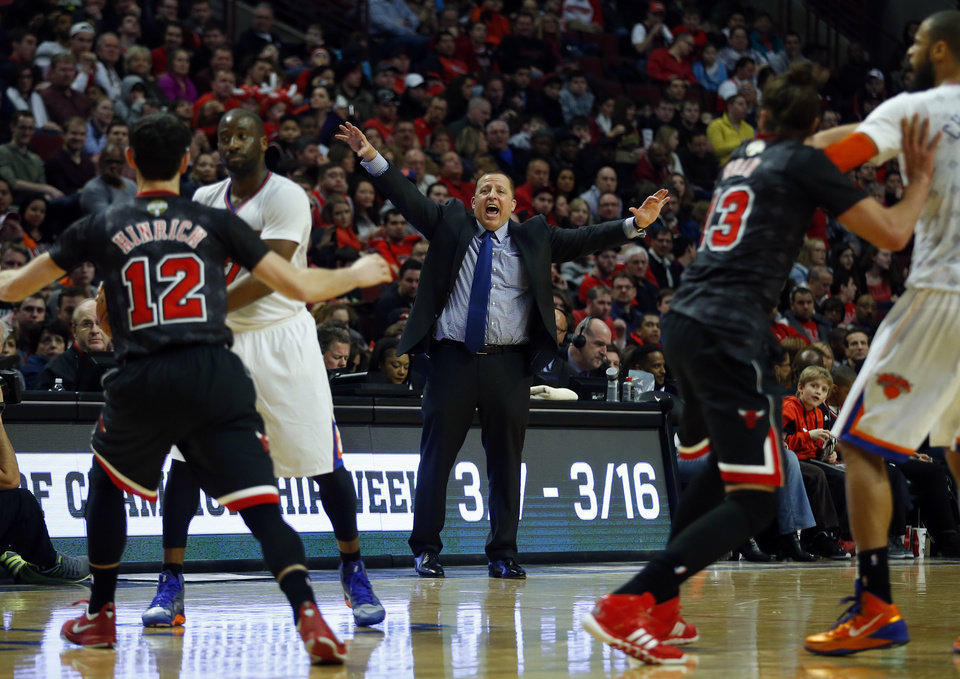 Photo - Chicago Bulls head coach Tom Thibodeau, center, calls out a play as his team plays the New York Knicks during the first half of an NBA basketball game on Sunday, March 2, 2014, in Chicago. (AP Photo/Jeff Haynes)
