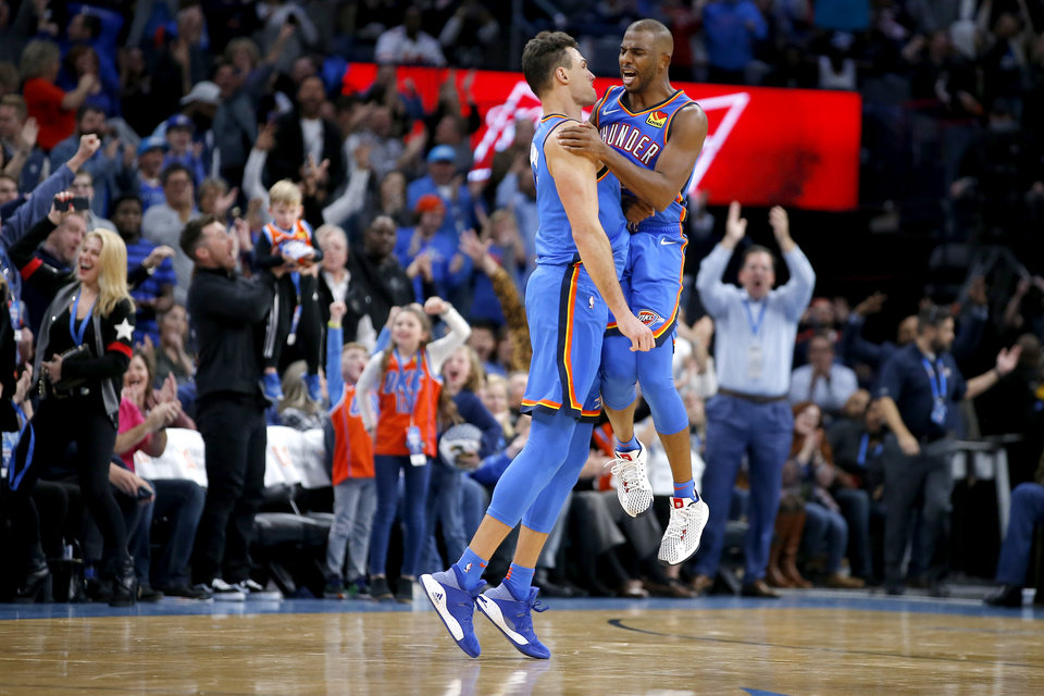 Photo - Oklahoma City's Danilo Gallinari (8) celebrates with Chris Paul (3) after making a 3-pointer in overtime of an NBA basketball game between the Oklahoma City Thunder and the Philadelphia 76ers at Chesapeake Arena in Oklahoma City, Friday, Nov. 15, 2019. Oklahoma City won 127-119. [Bryan Terry/The Oklahoman]