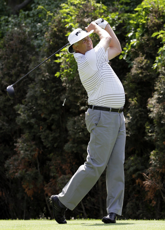 Photo - Kirk Triplett hits a tee shot on the eighth hole during the second round of the Encompass Championship golf tournament in Glenview, Ill., Saturday, June 21, 2014. (AP Photo/Nam Y. Huh)