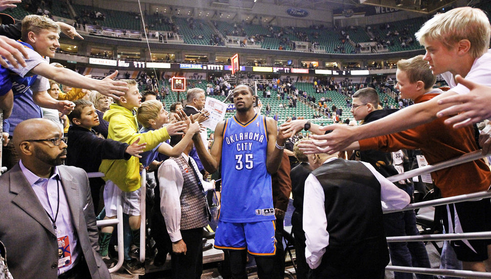 Fans reach for Oklahoma City Thunder's Kevin Durant at the end of an April game against the Utah Jazz. AP Photo