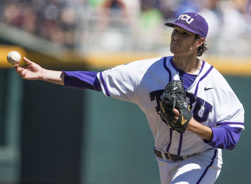 Photo - TCU pitcher Preston Morrison delivers against Texas Tech in the fifth inning of an NCAA baseball College World Series game in Omaha, Neb., Sunday, June 15, 2014. (AP Photo/Nati Harnik)
