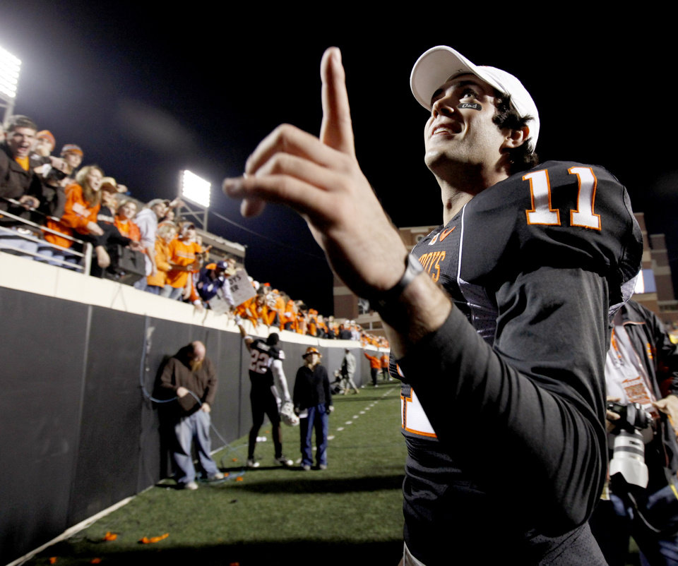 Photo - OSU's Zac Robinson waves to fans as he leaves after the college football game between Oklahoma State University (OSU) and the University of Colorado (CU) at Boone Pickens Stadium in Stillwater, Okla., Thursday, Nov. 19, 2009. Photo by Bryan Terry, The Oklahoman