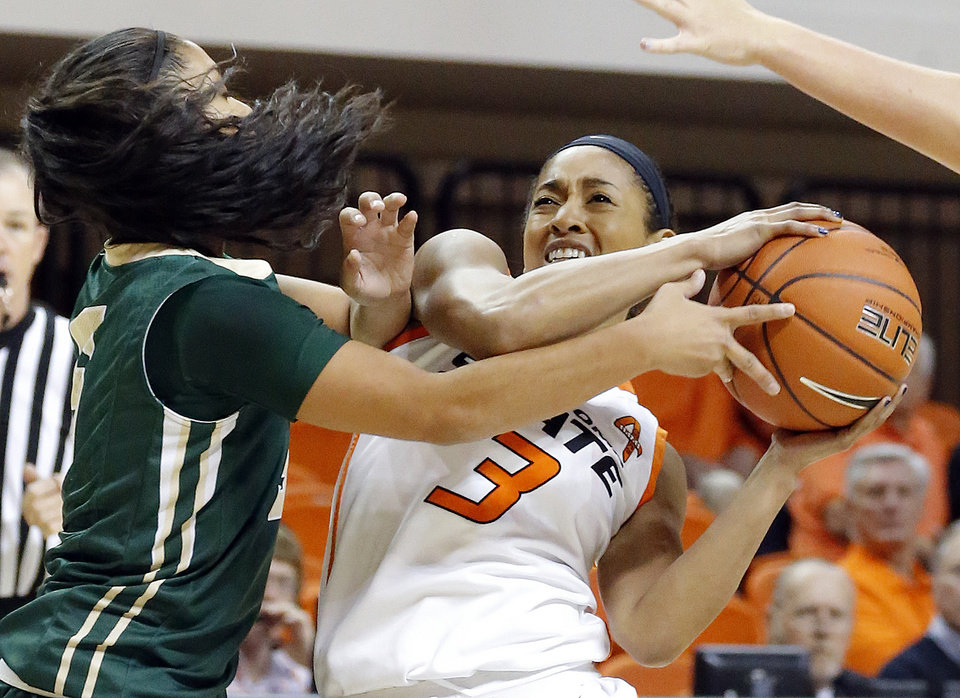 Oklahoma State's Tiffany Bias (3) tries to get around Cal Poly's Ariana Elegado (5) during the women's college basketball game between Oklahoma State and Cal Poly at  Gallagher-Iba Arena in Stillwater, Okla., Friday, Nov. 9, 2012. Photo by Sarah Phipps, The Oklahoman