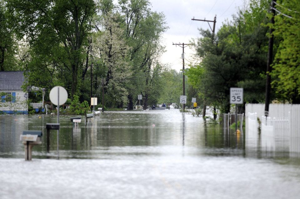Photo - Highway 811 in Beals, Ky. is flooded with several feet of water from the overflowing Green River Wednesday, April 27, 2011. (AP Photo/The Gleaner, Darrin Phegley)
