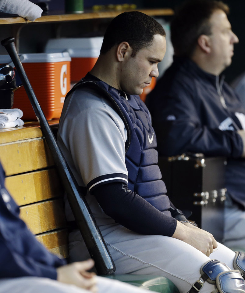 Photo -   New York Yankees' Russell Martin sits on the bench during the sixth inning during Game 4 of the American League championship series against the Detroit Tigers Thursday, Oct. 18, 2012, in Detroit. (AP Photo/Paul Sancya )