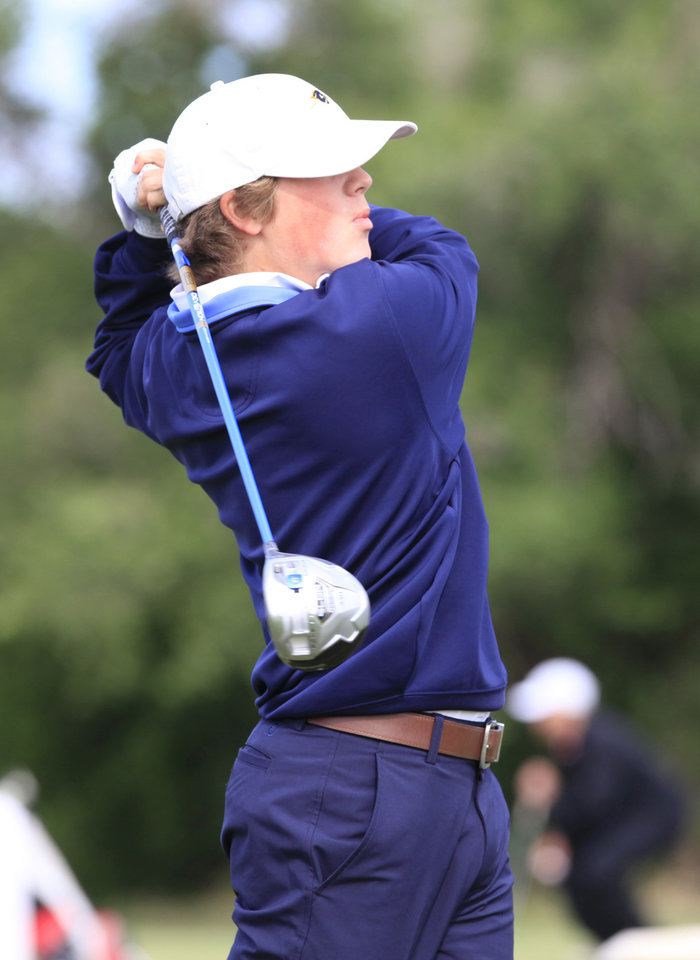 Photo - Tripp Harris, Heritage Hall, tees off in the Class 4A boys golf at Lake Hefner Golf Course, Tuesday May 13, 2014.  Photo by David McDaniel, The Oklahoman