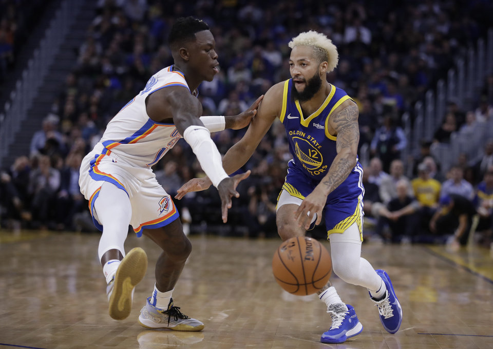 Photo - Golden State Warriors' Ky Bowman, right, drives the ball against Oklahoma City Thunder guard Dennis Schroder in the second half of an NBA basketball game, Monday, Nov. 25, 2019, in San Francisco. (AP Photo/Ben Margot)