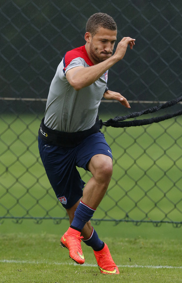 Photo - United States' Fabian Johnson works on resistance exercises during a training session at the Sao Paulo FC training center in Sao Paulo, Brazil, Tuesday, June 10, 2014. The U.S. will play in group G of the 2014 soccer World Cup. (AP Photo/Julio Cortez)