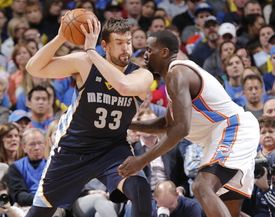 Oklahoma City's Kendrick Perkins (5) defends on Memphis' Marc Gasol (33) during the NBA basketball game between the Oklahoma City Thunder and the Memphis Grizzlies at Chesapeake Energy Arena on Wednesday, Nov. 14, 2012, in Oklahoma City, Okla.   Photo by Chris Landsberger, The Oklahoman